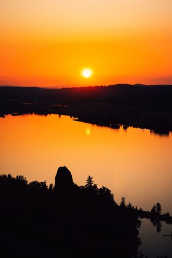 Sunset bliss. Sunset Orange Color Sky Silhouette Water Beauty In Nature Scenics - Nature No People Reflection Non-urban Scene Nature Idyllic Sun Plant Lake Sunlight Outdoors Tranquility Tranquil Scene Tree