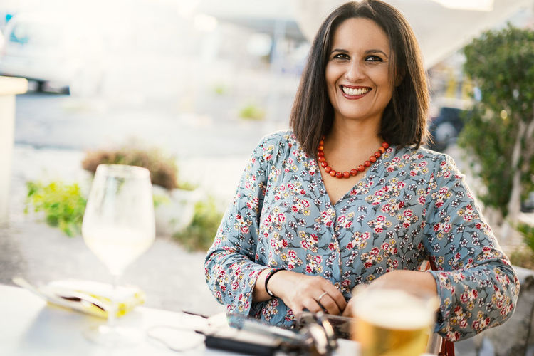 Portrait Of Smiling Woman At Restaurant