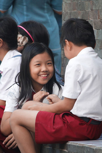 Students in Indonesian Uniform Children INDONESIA Kids Boys Casual Clothing Child Childhood Emotion Girls Group Of People Hairstyle Indonesia Photography  Leisure Activity Lifestyles Males  Men People Portrait Positive Emotion Real People Sitting Smiling Three Quarter Length Togetherness Women