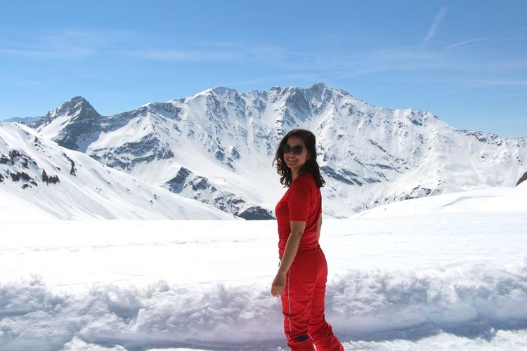 Mountain, snow, ski, confident woman, lady in red in the mountain, strong woman, mountain range Snow One Person Cold Temperature Winter Mountain Young Adult Leisure Activity Beauty In Nature Young Women Lifestyles Scenics - Nature Real People Standing Clothing Looking At Camera Portrait Mountain Range Snowcapped Mountain Women Day