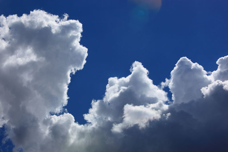 clouds in the sky, rain clouds, low pressure area Dark Clouds Backgrounds Beauty In Nature Blue Cloud - Sky Cloudscape Day Environment Full Frame Idyllic Low Angle View Low Pressure Area Meteorology Nature No People Outdoors Rain Clouds Scenics - Nature Sky Softness Sunlight Tranquil Scene Tranquility White Color Wind