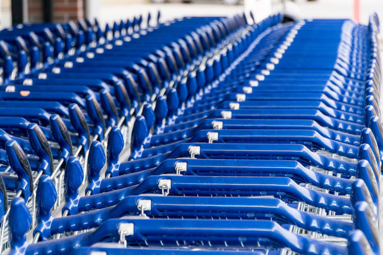 Close-Up Of Shopping Carts Arranged At Supermarket