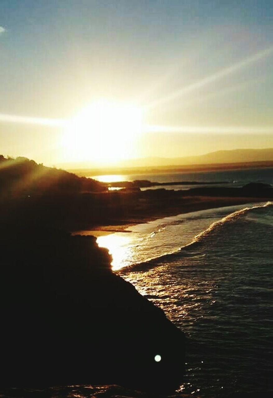 sunset, sun, sunlight, sea, scenics, beauty in nature, sunbeam, nature, silhouette, water, tranquility, tranquil scene, sky, beach, no people, outdoors, horizon, horizon over water, day