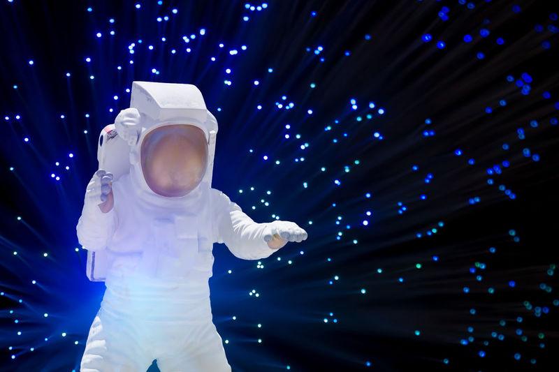 Astronaut toy against fiber optics