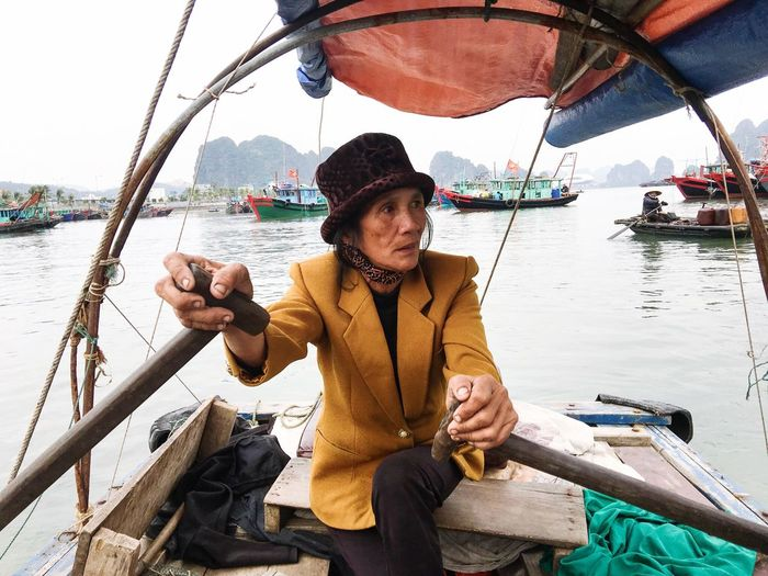 Work hard. Nautical Vessel One Person Water River Casual Clothing Mode Of Transport Mature Adult Real People Transportation Outdoors Day Sailing Lifestyles Sitting Adult Adults Only People Only Women Sky Halong Bay Vietnam Vietnam Halongbay Vietnamese Travel Sail EyeEm Selects