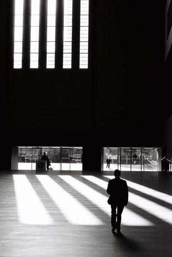 Man walking out of the Turbine Hall, Tate Modern, London Architecture Architecture Photography Built Structure Indoors  Men Silhouette Tate Modern The Architect - 2017 EyeEm Awards Turbine Hall Walking