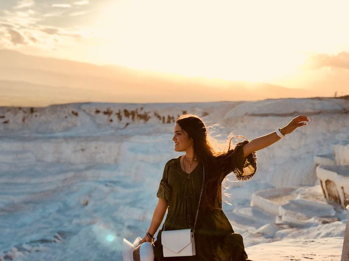 Smiling Young Woman Gesturing While Standing At Pamukkale