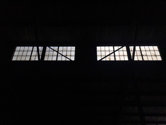 Silhouette of window in dark room
