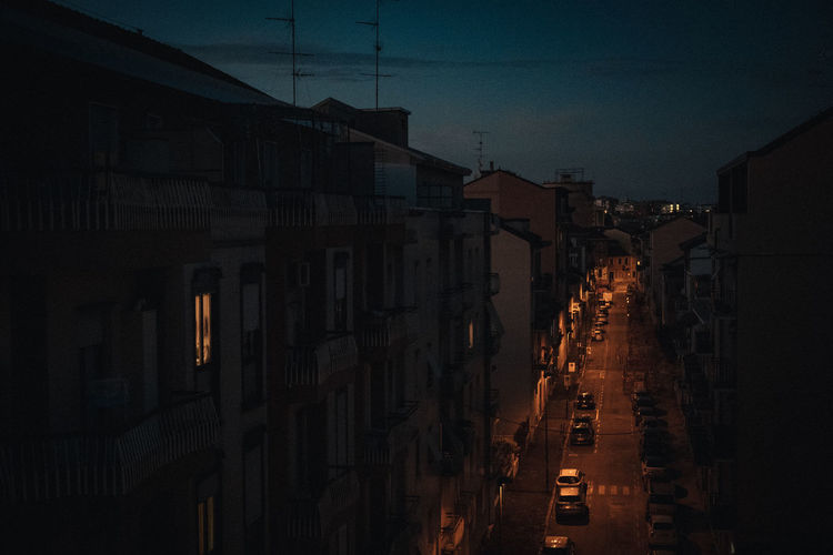 Panoramic view of city street and buildings at night