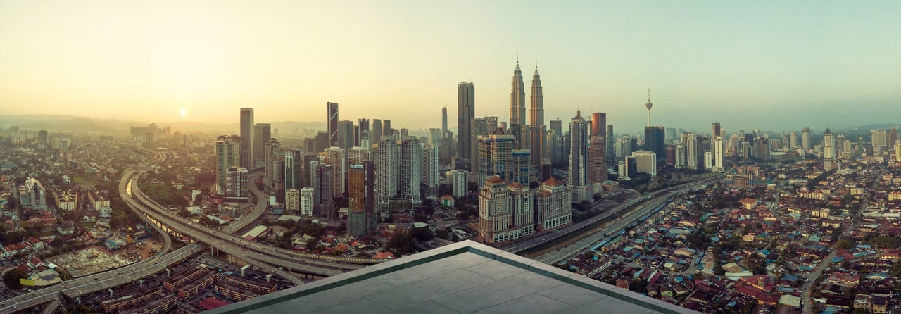 Panoramic view of cityscape against clear sky during sunset