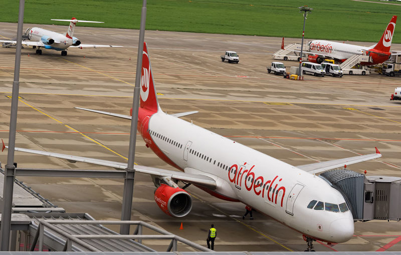 A plane of Air Berlin at the airport of Leinfelden-Echterdingen Business Air Berlin Air Vehicle Airplane Airport Airport Runway Bankrupt Commercial Airplane Day Financial Crisis Mode Of Transport News No People Outdoors Red Runway Transportation
