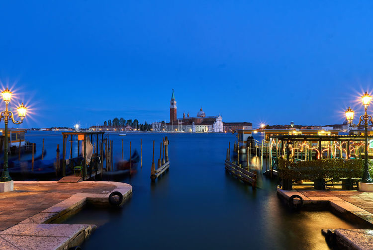 St marks square by grand canal against clear blue sky at dusk
