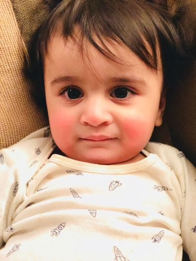 Innocence looking into camera Baby Photography Model Baby Gerber American Indian Looking In Your Eyes Looking In Camera Red Cheeks Cute Smiling Baby On Couch Couch Kids Kid Naughty Boy Baby Boy Babyboy Baby Indian American