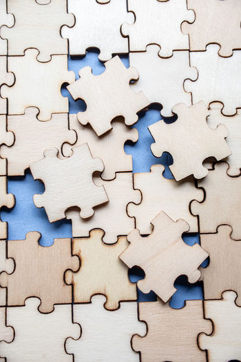 High angle view of wooden jigsaw puzzle