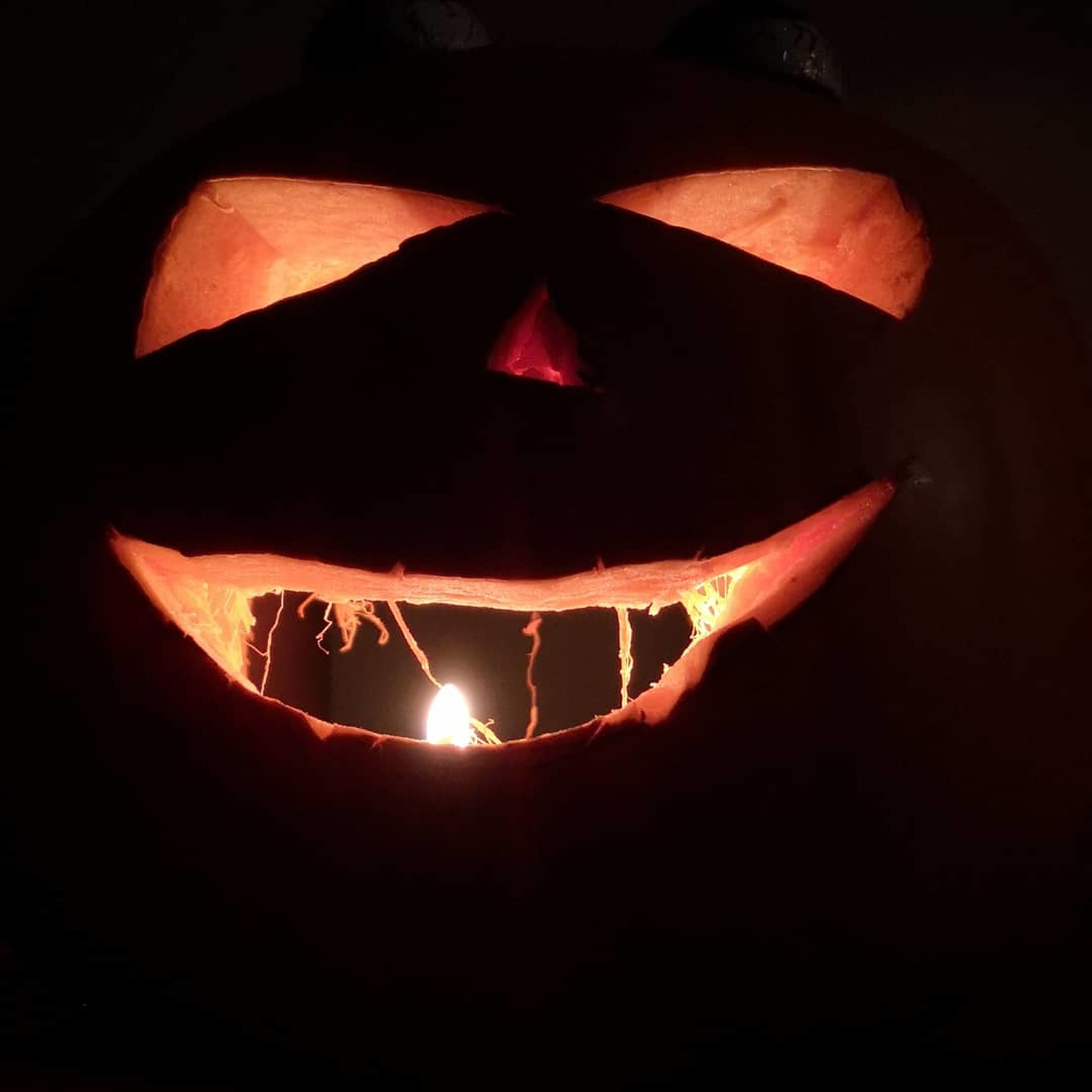 illuminated, halloween, celebration, anthropomorphic, food and drink, anthropomorphic face, face, no people, close-up, pumpkin, food, indoors, creativity, orange color, jack o' lantern, black background, night, art and craft, spooky, glowing, dark