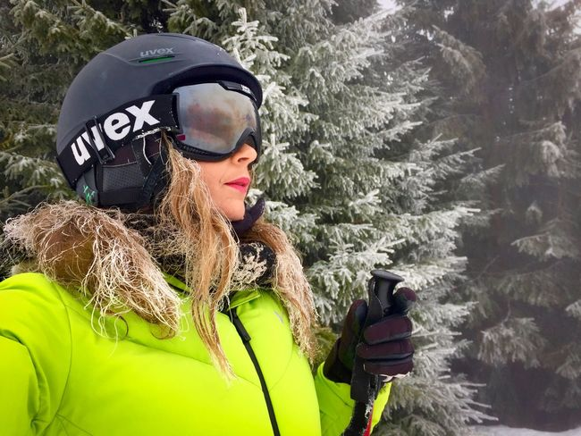Portrait of woman wearing Uvex ski glasses and Uvex ski helmet and holding ski poles with pine cone trees covered in snow in the background Fog Trees Conifers Snow Ski Glasses Ski Helmet Uvex Portrait Skiing Skier Adventure Real People Day Backpack Leisure Activity Outdoors Headwear Lifestyles One Person Vacations Sports Helmet Young Adult Cold Temperature Extreme Sports One Woman Only Nature Warm Clothing
