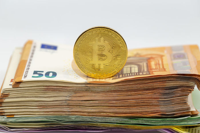 Bitcoin token on white background, on top of many euro banknotes money. Cryptocurrency versus paper currency concept BTC Banknotes Copy Space E-commerce Gold Isolated Virtual Bit  Bitcoin Bussiness Coin Concept Crypto Cryptocurrency Cypto Currency Euro Exchange Future Internet Minning Minning Bitcoin Money Pay Symbol White Background