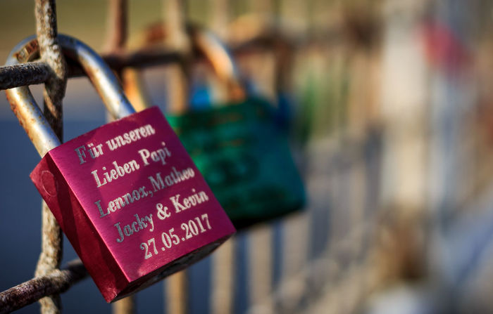 Close-up Communication Day Focus On Foreground Hanging Hope Lock Love Lock Metal No People Outdoors Padlock Railing Text