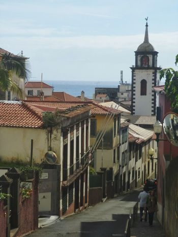 Looking down the street Streetphotography Street Photography Old Buildings Tiled Roof  Churchtower Funchal Madeira