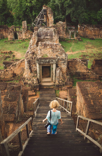 Siem Reap Cambodia Angkor Curly Hair Girl Architecture History Full Length Built Structure Rear View The Past Travel Destinations Place Of Worship Religion Staircase One Person Ancient Tourism Belief Day Spirituality Building Exterior Childhood Outdoors