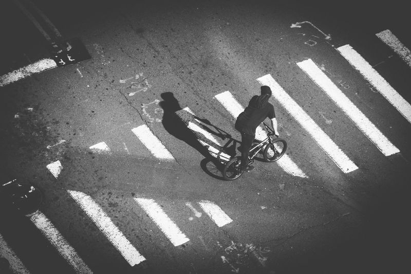 High angle view of man with bicycle on street