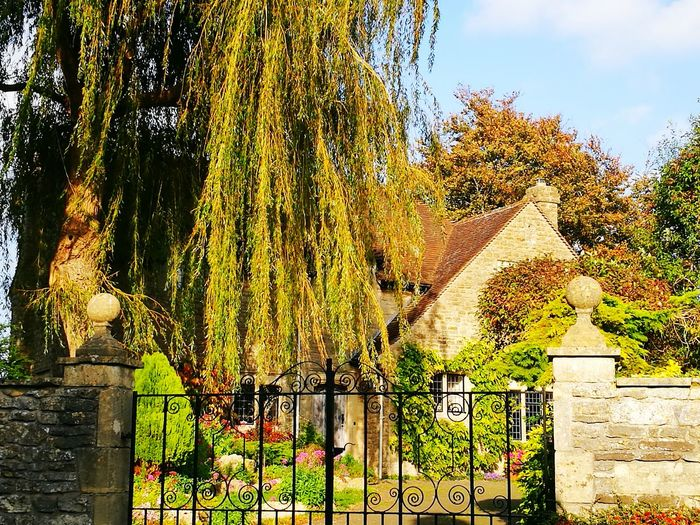 Tree Outdoors Day No People Nature Sky Iron Gates Building Exterior Cotswold Stone Cotswold Gate Posts Weeping Willow Tree
