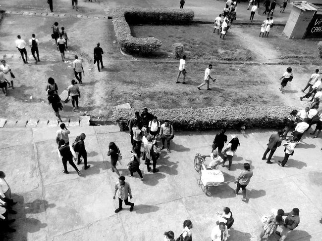 Busy people Large Group Of People High Angle View Real People Men Women Day People Outdoors Blackandwhitephotography Black & White Shadows Lifestyles Black And White Photography Streetphotography Street Photography Street Art Aerial Shot Aerial Photography Aerial View Aerial Adapted To The City