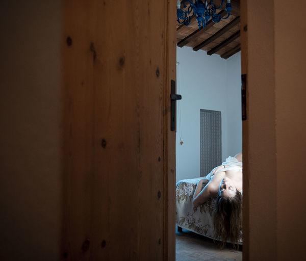 Dog relaxing on open door