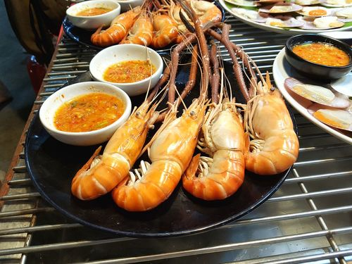Grilled seafood Seafood Yum:) Grilled Hot Sauce Fresh Dish Cooked Shrimp Sellfish Food And Drink Food Seafood Freshness Plate Ready-to-eat Healthy Eating High Angle View Serving Size Indoors  Shrimp No People Meal Day Close-up