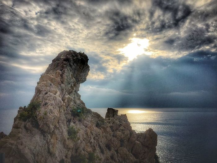 Sky Cloud - Sky Sea Water Nature Beauty In Nature Land Beach Scenics - Nature Tranquility Tranquil Scene Rock No People Sunlight Sunset Horizon Over Water Solid Rock - Object Outdoors