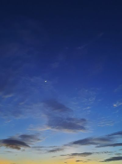 Low angle view of blue sky at night