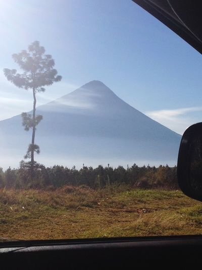 Agua Volcano, Guatemala . Volcano Volcanic Landscape Volcano Landscape Volcan De Agua Guatemala City Mountain Tranquil Scene Landscape Tree Clear Sky Outdoors Day Nature Rural Scene Beauty In Nature No People Remote Volcanologist Tall - High Triangular Cone Love Volcanoes Volcano Addicted
