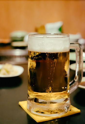 Glass of draft beer in the cafe pub restaurant. Alcohol Beer Beer - Alcohol Beer Glass Close-up Drink Drinking Glass Food Food And Drink Freshness Frothy Drink Indoors  No People Refreshment Table