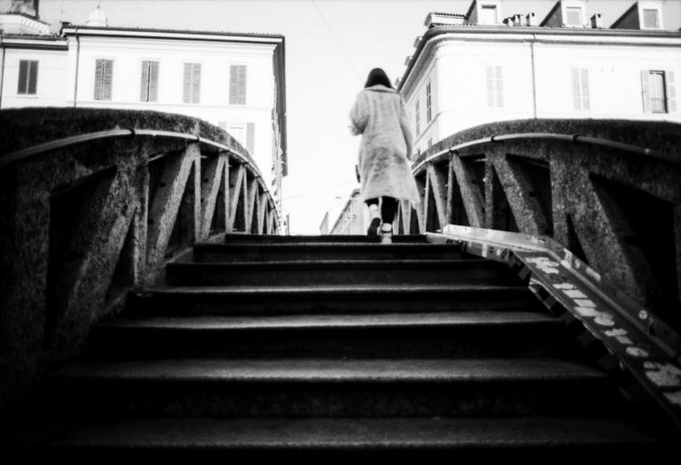 Low angle view of woman on staircase of building