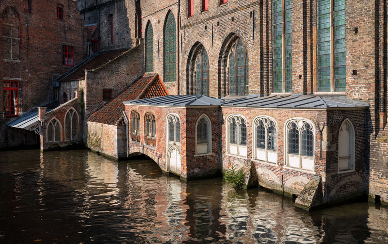 Historic buildings on the canals of bruges, belgium