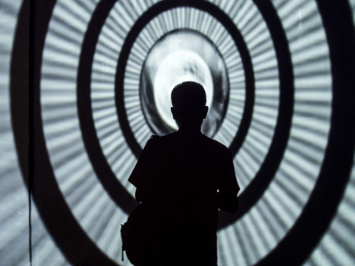 Silhouette of man standing indoors
