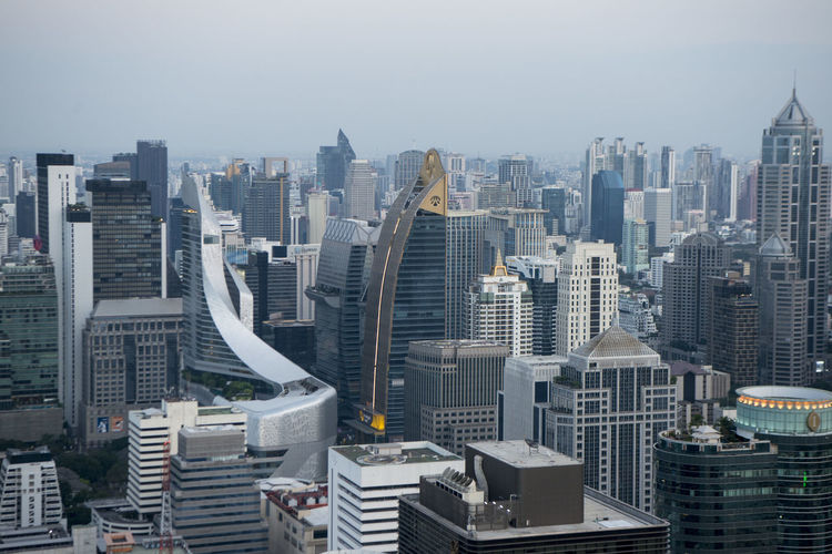 High angle view of modern buildings against sky in city