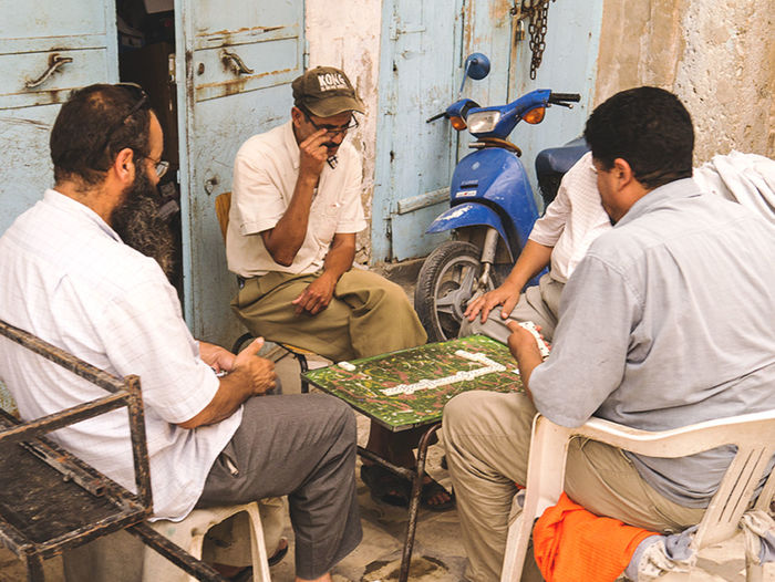 Men playing dominoes outdoors in Tunis Adult Dominoes Dominos Men Men Playing Dominoes Men Playing Dominos Outdoors People Sitting Tunis Tunisia