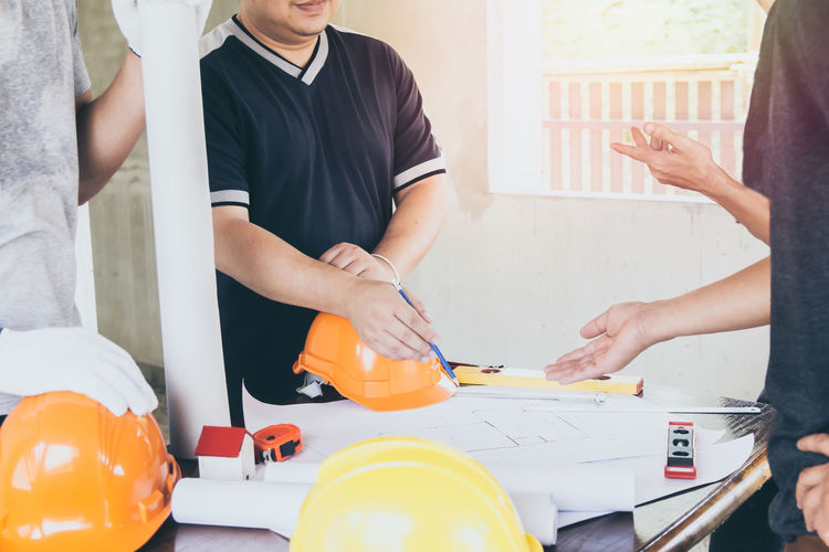 Midsection of woman working on table