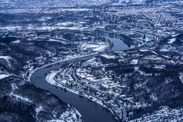 High angle view of snow covered road in city