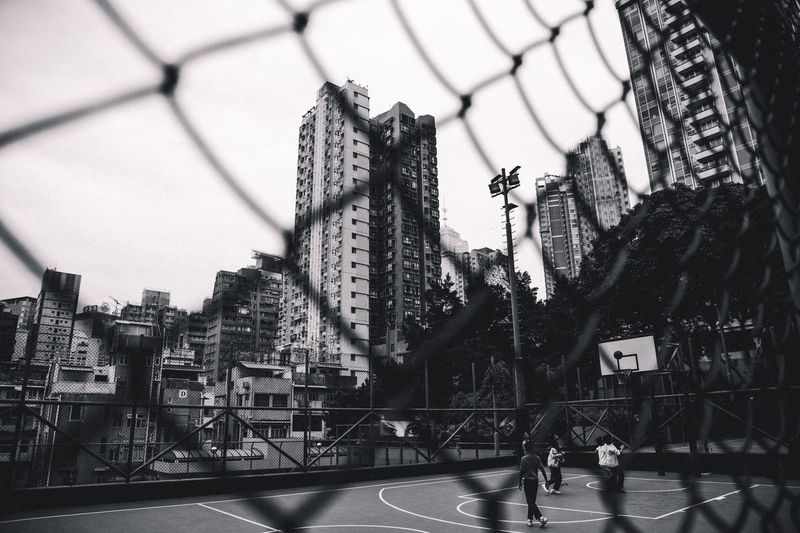 Urban life - playing basketball in the middle of the city