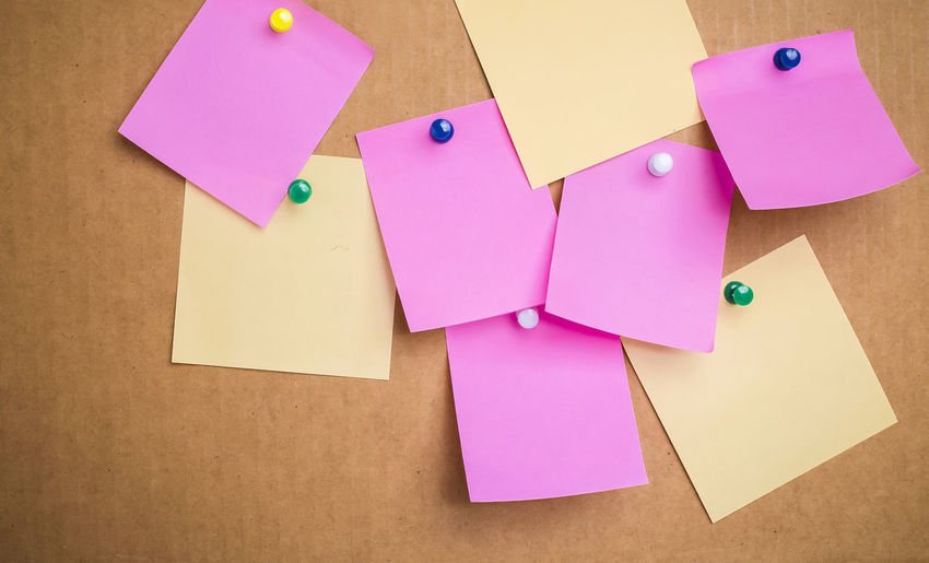 Close-up of sticky notes on cardboard box