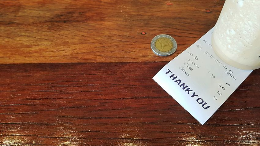 Smoothie with receipt and Thai coin on wooden floor Table Text Indoors  High Angle View Freshness Close-up No People Day Receipt Paper Thai Text Text Letters Coffee Shop Cool Smoothie Juice Cool Drink ıced Coffee Texture Wooden Board Ten Baht Coin Thai Baht Currency Money