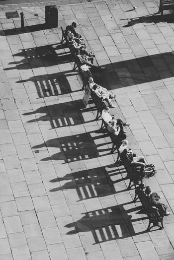 Benches Cobblestone Communication Flooring Footpath Guidance Information Lifestyles Low Section Modern Pairs Pattern Pavement Paving Stone Shadow Shadows Sidewalk Street Sun Bathing Sunset A Bird's Eye View Urban View From Above Walking Dramatic Angles Lost In The Landscape Black And White Friday #urbanana: The Urban Playground 17.62°