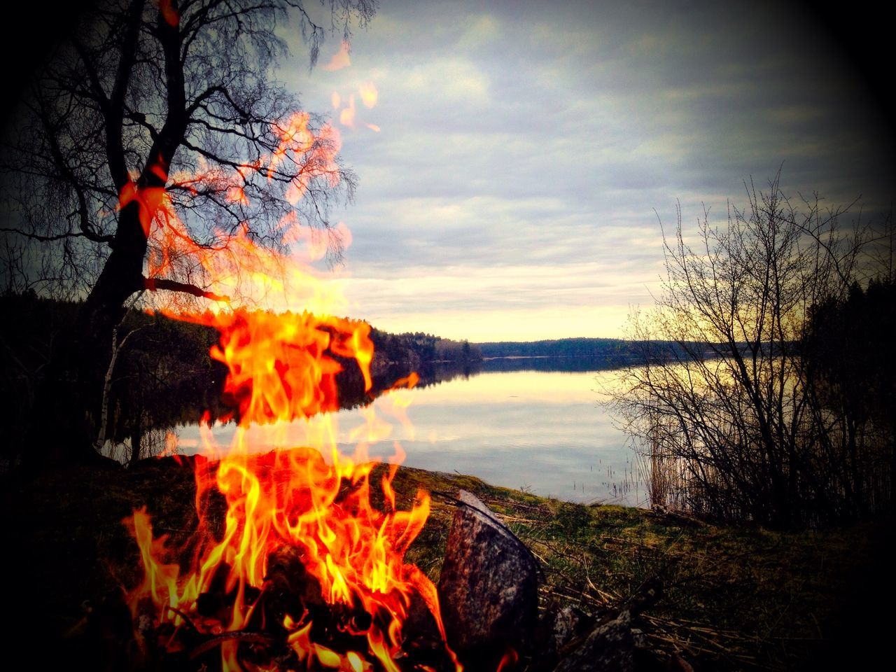 Burning Campfire And Lake