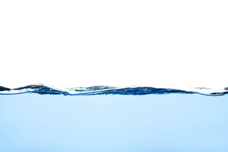 Close-up of water over white background