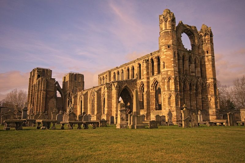 Elgin Cathedral By Cemetery Against Sky During Sunset