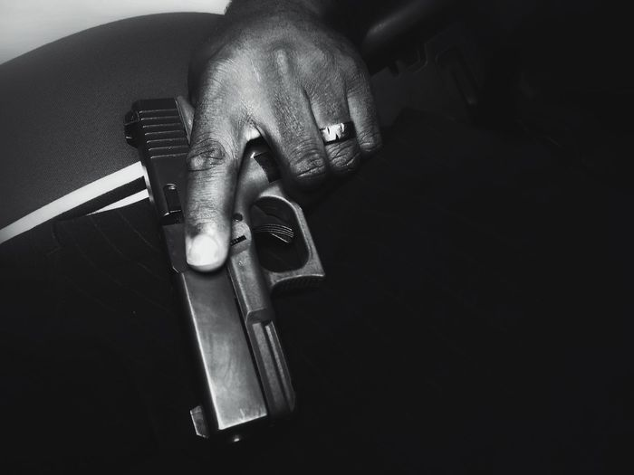 High angle view of man holding weapon