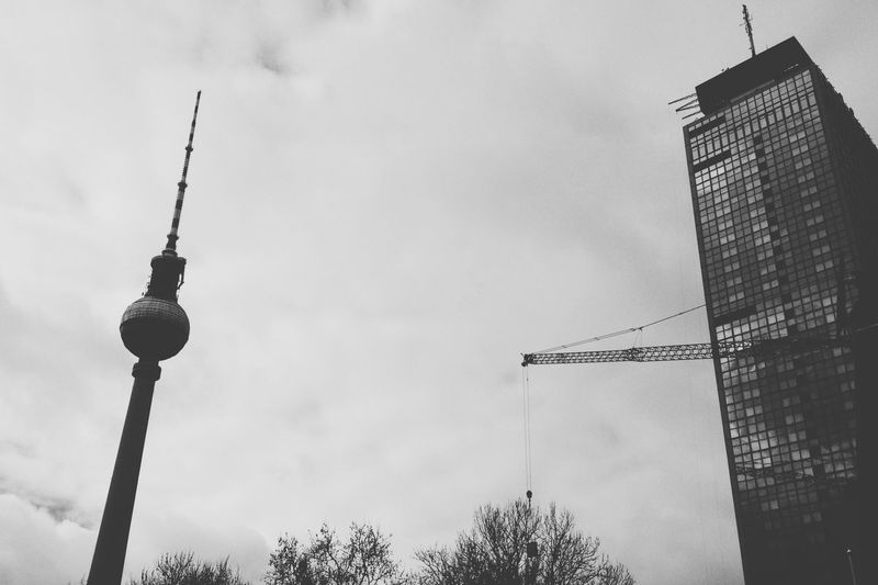 Communication Tower And Building Against Sky