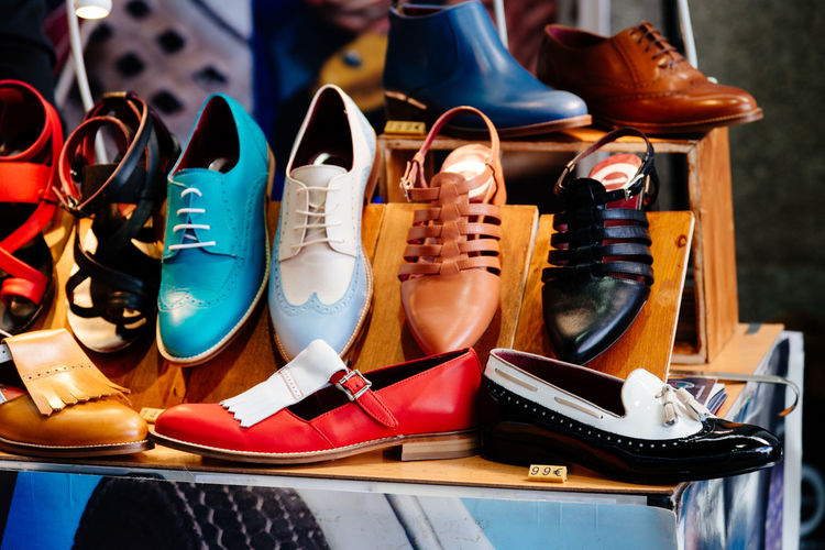 Fashion shoes in art and craft market Art And Craft Market Antiques Arrangement Business Choice Close-up Fashion For Sale In A Row Indoors  Large Group Of Objects Menswear Multi Colored No People Order Retail  Retail Display Sale Shoe Still Life Store Table Variation Womenswear